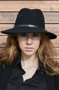 Mid adult woman wearing black hat - IGGF00560