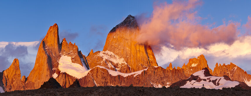 A person in front of Mount Fitzroy at sunrise. - AURF03773