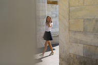 Young woman walking in the city - GIOF04286
