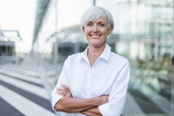 Portrait of smiling senior businesswoman outside - DIGF05031