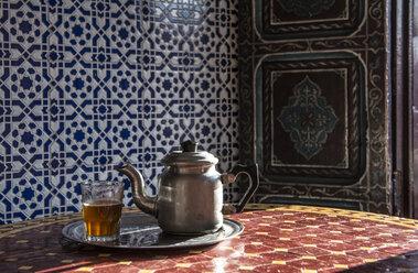 Mint tea in glass and tea pot on table, Marrakesh, Morocco - AURF03999