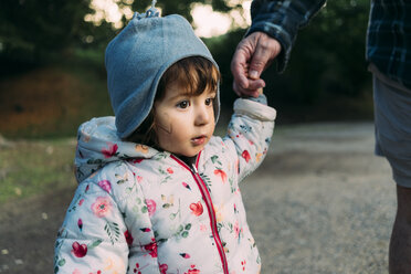 Portrait of fashionable little girl walking hand in hand with her grandfather in autumn - GEMF02404