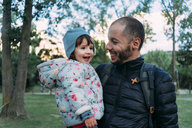 Father and little daughter having fun together in autumnal park - GEMF02410