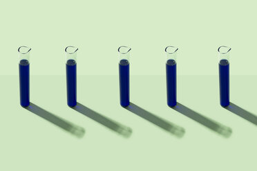 Row of test tubes with blue liquid, green background - DRBF00086