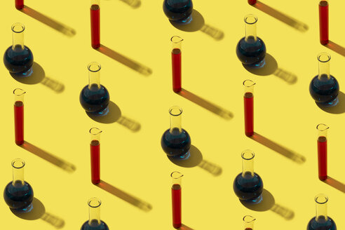 Row of test tubes with liquid, yellow background - DRBF00092