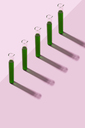 Row of test tubes with liquid, pink background - DRBF00095