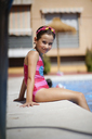 Young girl wearing swimmming goggles, at swimming pool - JSMF00443