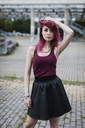 Portrait of young woman with dyed hair posing outdoors - MAUF01716