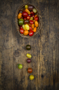 Basket of Heirloom tomatoes on wood - LVF07419