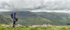 UK, Lake District, Longsleddale valley, mature man with backpack in rural landscape - ALRF01274