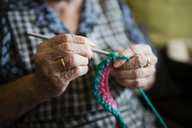 Hands of senior woman crocheting, close-up - RAEF02136