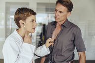Female doctor examining patient with a stethoscope - MFF04489