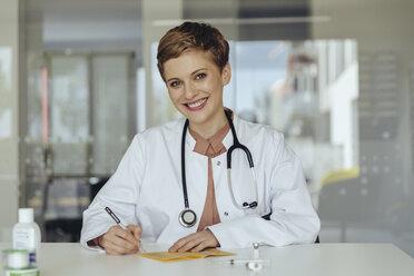Portrait of a confident female doctor, filling in immunization card - MFF04507