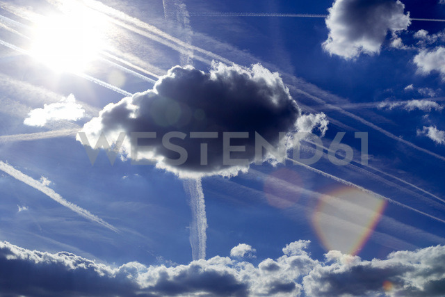 Blue sky with clouds, sun and vapour trails - NDF00795