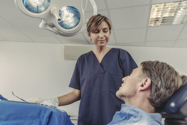 Dental surgeon talking to patient before treatment - MFF04567
