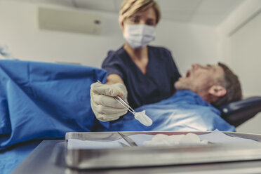 Dental surgeon during surgical procedure on a patient - MFF04570