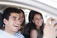 Friends having fun on a road trip, taking smartphone selfies - PACF00099