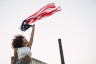 Young woman waving American flag - KKAF01769