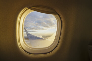 View out of window on wing of a plane - KKAF01797