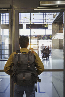 Young man with backpack standing at the airport - KKAF01806