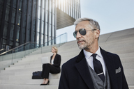 Portrait of fashionable mature businessman wearing sunglasses - RORF01477