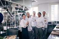 Portrait of chefs standing together in commercial kitchen - MASF08661