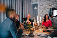 Mature friends enjoying dinner party at home - MASF09057