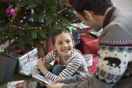 Father and daughter opening Christmas gifts - HOXF03827