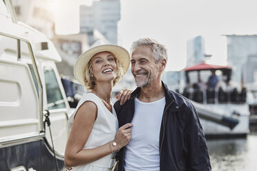 Older man and young woman at a marina next to a yacht - RORF01563