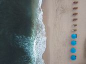 Indonesia, Bali, Aerial view of Balangan beach, empty sun loungers - KNTF01414