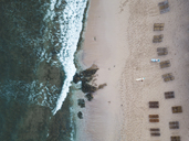 Indonesia, Bali, Aerial view of Balangan beach, empty beach loungers from above - KNTF01420