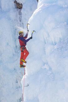A man ice climbing near Ouray, Colorado. - AURF04041