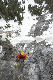 A man ice climbing near Ouray, Colorado. - AURF04044