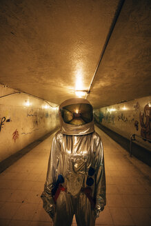 Spaceman in the city at night standing in underpass - VPIF00649
