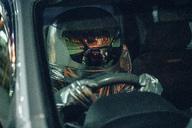Spaceman driving car at night - VPIF00685