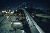 Spaceman waving out of car at night - VPIF00691