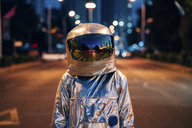 Spaceman on a street in the city at night - VPIF00712