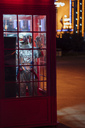 Spaceman standing in a telephone box at night - VPIF00748