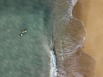 Indonesia, Bali, Aerial view of Pandawa beach, two surfers - KNTF01443