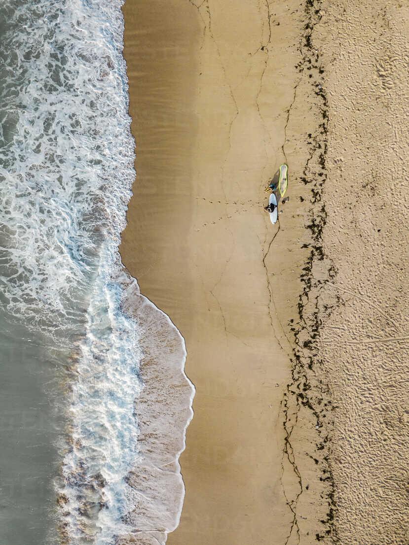 Indonesia, Bali, Aerial view of Pandawa beach, two surfers - KNTF01446 - Konstantin Trubavin/Westend61
