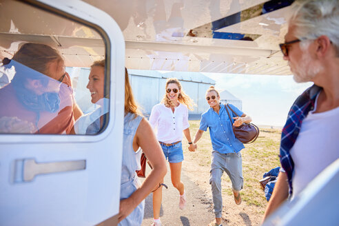 Friends boarding small airplane - CAIF22158