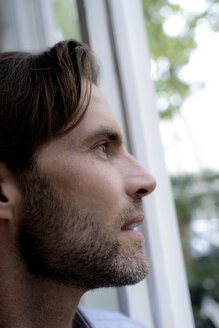 Close-up of man looking out of window - HHLMF00367