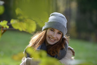 Portrait of smiling teenage girl in autumnal forest - LBF02053