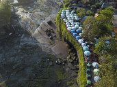 Indonesia, Bali, Aerial view of sunshades at Tanah Lot-temple - KNTF01507