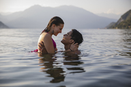 Happy affectionate young couple in a lake - MRAF00283