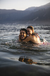 Happy carefree young couple in a lake - MRAF00301