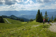 Germany, Bavaria, Brauneck near Lenggries, young couple hiking in alpine landscape - LBF02081