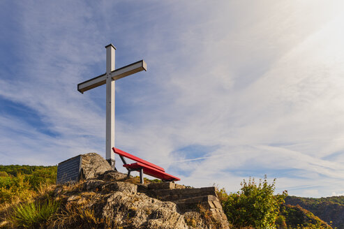 Germany, Rhineland-Palatinate, Altenahr, Ahr Valley, red bench and white summit cross - FRF00724