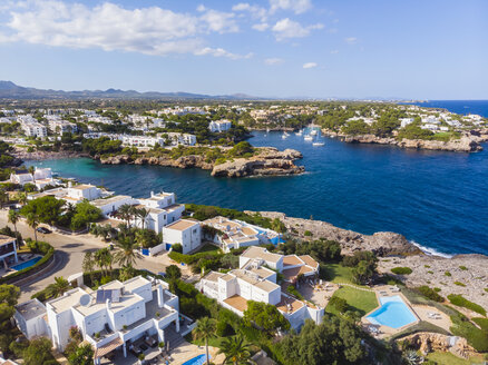 Spain, Mallorca, Portocolom, Aerial view of Cala d'Or and bay Cala Ferrera - AMF05923