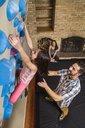 Family Playing With Climbing Gym In Their House - AURF05039